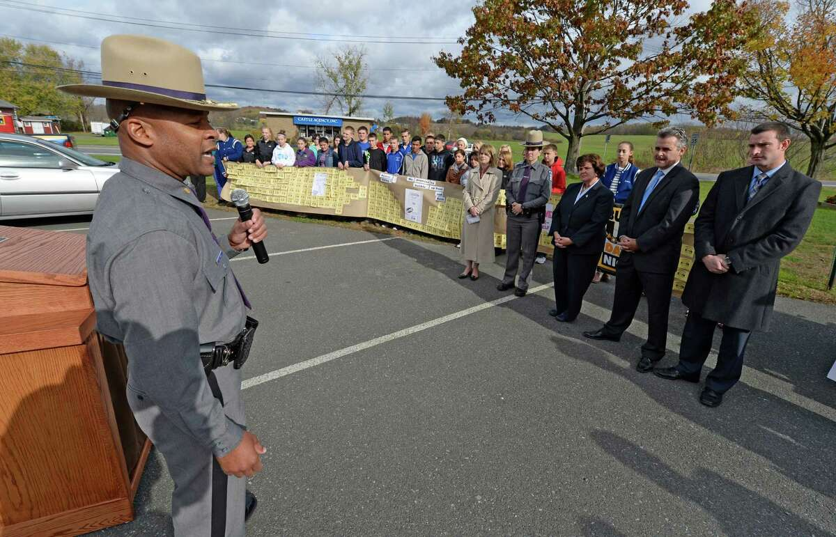 Troop G Major Steven James, left, address students from Hoosic Valley High School Friday morning, Oct. 25, 2013, during a press briefing to promote safe driving held by at the Hoosic Valley High School in Schaghticoke, N.Y. The students displayed a poster which created to promote safe driving. (Skip Dickstein / Times Union)