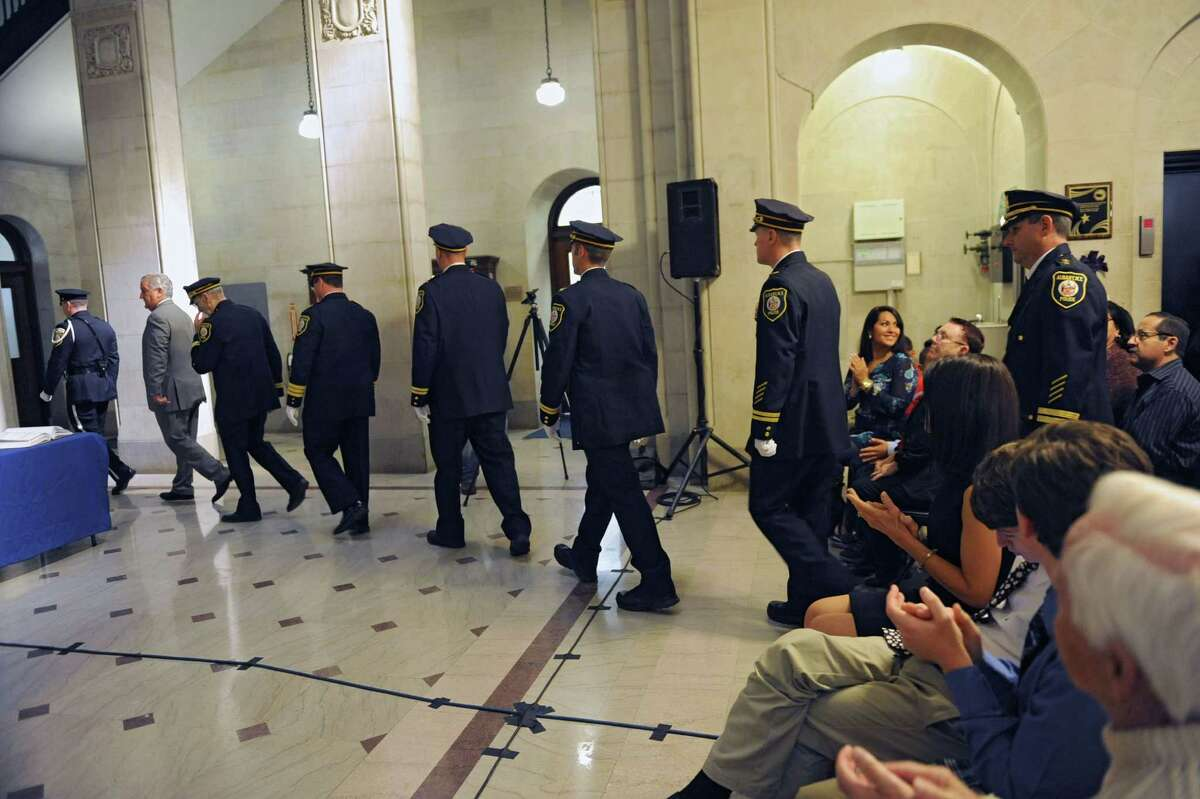 Mayor Jerry Jennings enters the Albany City hall rotunda with members of the Albany Police Department during a promotions ceremony Friday, Oct. 25, 2013, in Albany, N.Y. (Lori Van Buren / Times Union)