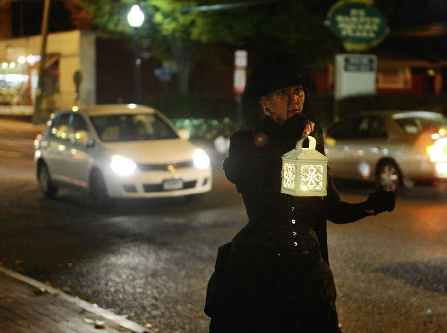 Ava Heydt walks the streets as the Spirit of Bethel, looking for her lost husband, during the Bethel Haunted Ghost Tour, hosted by the local author and storyteller Marty Bishop, in Bethel, Conn. on Friday, Oct. 25, 2013.  The event, presented by the Bethel Historical Society, toured historic downtown Bethel, making stops to tell ghost stories and the history of ghost sightings in the area. Photo: Tyler Sizemore / The News-Times