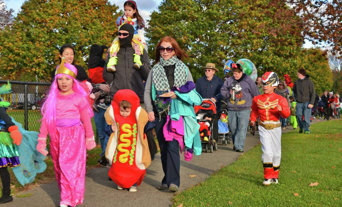 Children and families march in the Halloween costume parade at Clifton Common Friday Oct. 25, 2013, in Clifton Park, N.Y. (John Carl D'Annibale / Times Union)