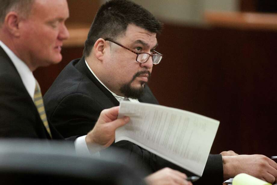 Defendant Jorge Amezquita sits in the courtroom with his attorney Danny Easterling,front, on Tuesday, May 28, 2013, in Houston.  Amezquita is accused of killing Leo Gomez Sr. and his wife, Milagro Vanegas, both 53, during a home invasion June 24, 2008. ( J. Patric Schneider / For the Chronicle ) Photo: J. Patric Schneider, Freelance / © 2013 Houston Chronicle