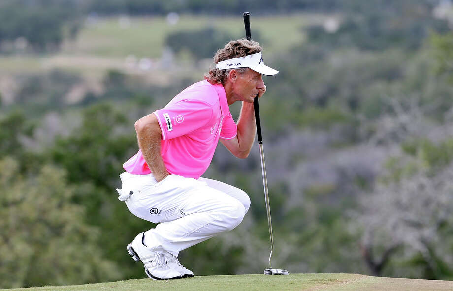 Bernhard Langer lines up a putt on No. 17 during the first round of the AT&T Championship held Friday Oct. 25, 2013 on the AT&T Canyons Course at TPC San Antonio. Photo: Edward A. Ornelas, San Antonio Express-News / © 2013 San Antonio Express-News