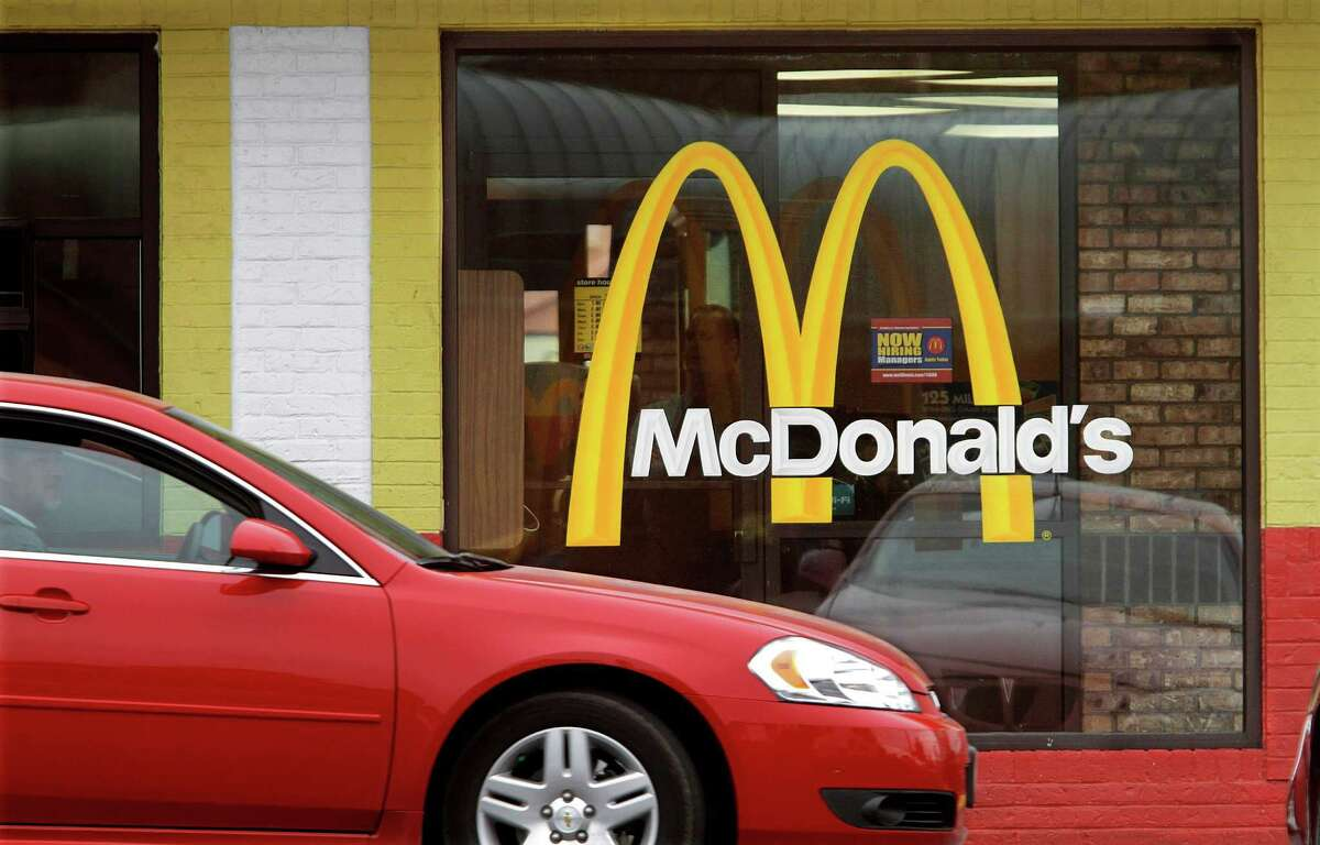 FILE - In this Oct. 17, 2011 file photo, a car moves through a McDonald's drive through window line, in Springfield, Ill. The fast-food giant said in a statement Friday, Oct. 25, 2013, that it is cutting ties with condiment company Heinz after 40 years due to management changes there. A former Burger King CEO became head of Heinz in June after the company was bought by Warren Buffett's Berkshire Hathaway and 3G Capital. 3G, a Brazilian investment firm, also controls Burger King. (AP Photo/Seth Perlman, File)