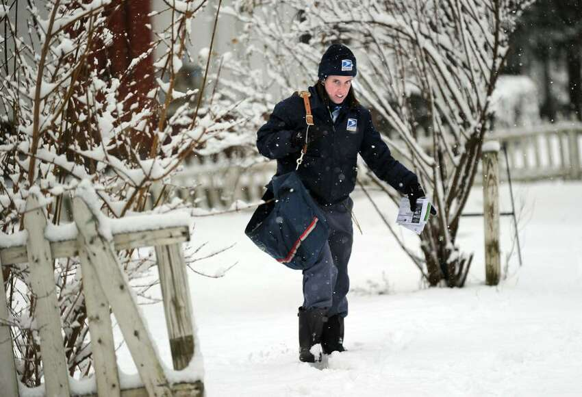 Mail Carrier Emma Pieper of Danbury trudges through the snow as she makes her delivery rounds on Fairview Ave. in Danbury Thursday, January 28, 2010.