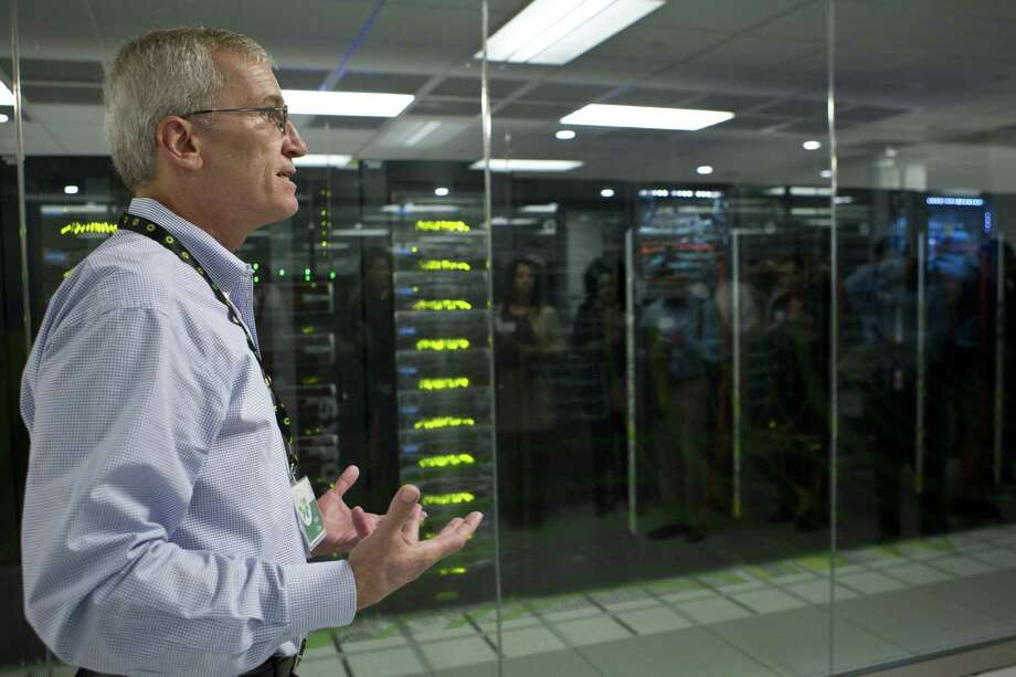 Keith Gray, manager at BP's center for high-performance computing, talks about the research capabilities possible with the supercomputers during Tuesday's grand opening of the center at BP's U.S. headquarters in Houston. Photo: Marie D. De Jesus / Houston Chronicle