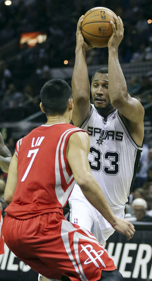 "Boris Diaw and the Spurs wrapped up the preseason against Jeremy Lin and the Rockets on Thursday. ""We're glad it's over and we can start on the serious things,"" Diaw said. Photo: Edward A. Ornelas / San Antonio Express-News"