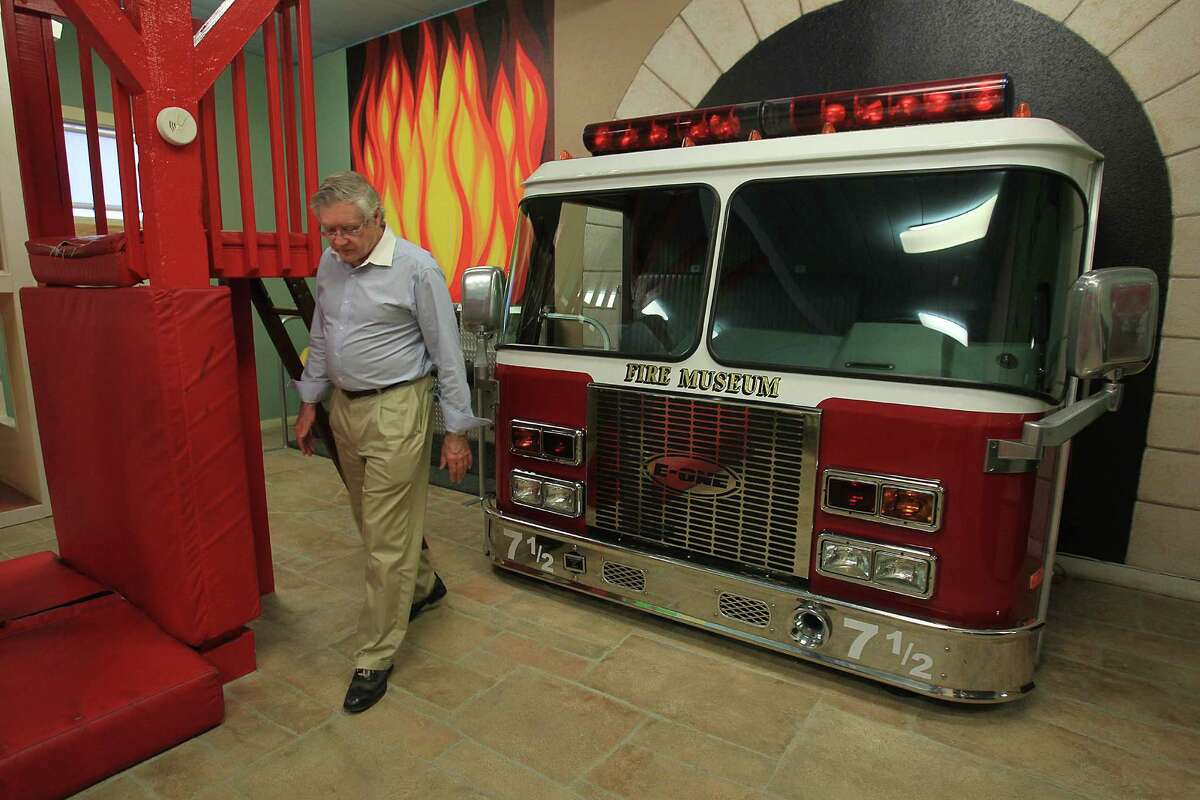 Bill Edge, fire museum board member, walks through the children's area of the old firehouse. Plans for a $15 million midtown museum have been scrapped, but sale of its proposed site may help preserve the station.