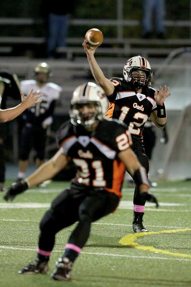 Shelton High School's quarterback # 12 Mark Piccirillo eyes a receiver during Friday evening match against Daniel Hand High School. Photo: Mike Ross / Mike Ross Connecticut Post freelance - @www.mikerossphoto.com