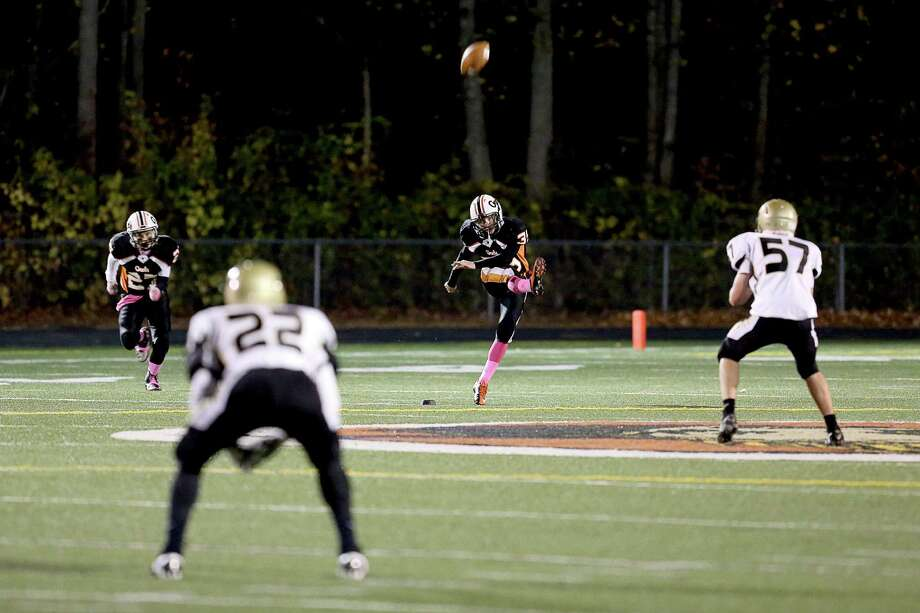 Shelton High School's kicker #35 Brian Messemer kicks to Daniel Hand High School defense during Friday evening match-up. Photo: Mike Ross / Mike Ross Connecticut Post freelance - @www.mikerossphoto.com