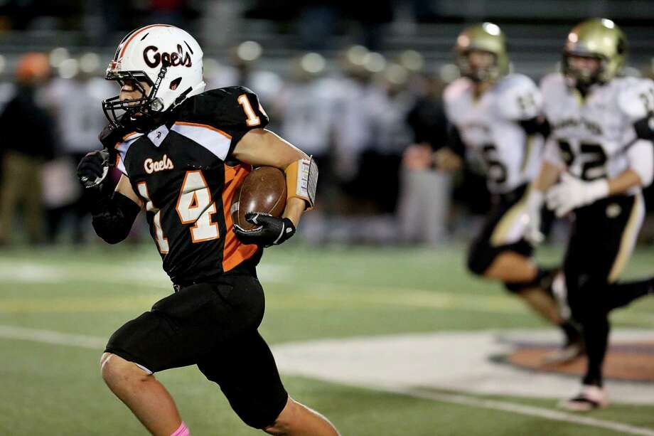 Shelton High School's # 14 Michael Pingree runs a 90 yard plus touchdown kick off return against Daniel Hand High School during Friday evening match-up. Photo: Mike Ross / Mike Ross Connecticut Post freelance - @www.mikerossphoto.com