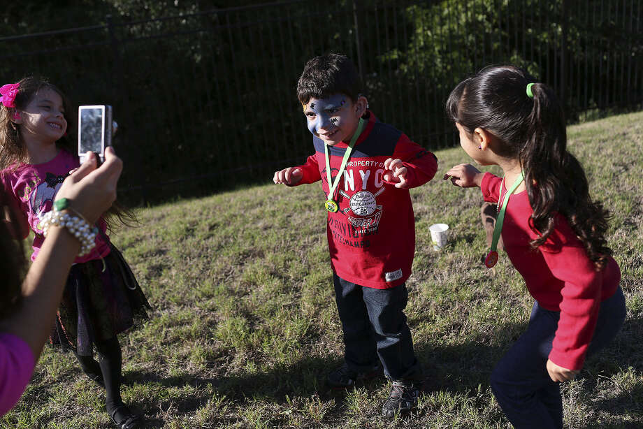 Joaquin Januario, 4, makes like a bat as he plays with classmates Clarissa Martinez, 5, (left), and Addison Manjarrez, 4, during the Early Childhood Fall Fest at Sunshine Cottage School for Deaf Children. Photo: Lisa Krantz / San Antonio Express-News