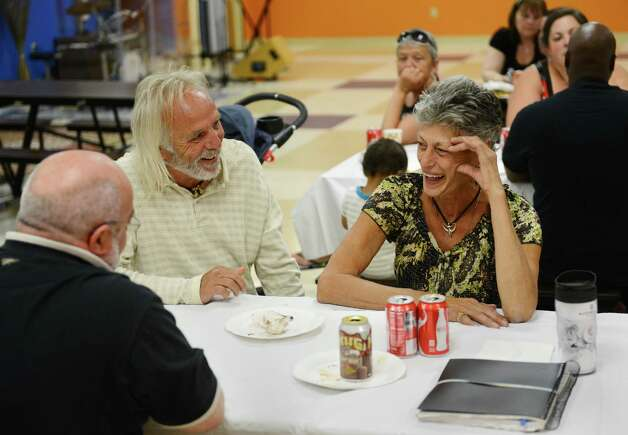 Former Staten Island residents Dennis Klaus and Maryann Daino laugh with each other while talking during a pizza lunch at Faith Church in New Milford, Conn. on Sunday, Aug. 11, 2013.  Klaus and Daino have a group lunch every Sunday with other members of the community living at the mobile home camp for Superstorm Sandy victims. Photo: Tyler Sizemore / The News-Times