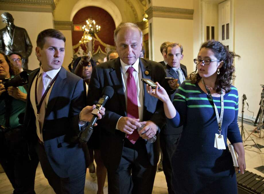 """U.S. Rep. Steve King, R-Iowa (center), explains his stance on immigration reform by saying: """"We have seen the character of this president and the way that he does business."""" Photo: Associated Press / File Photo"""