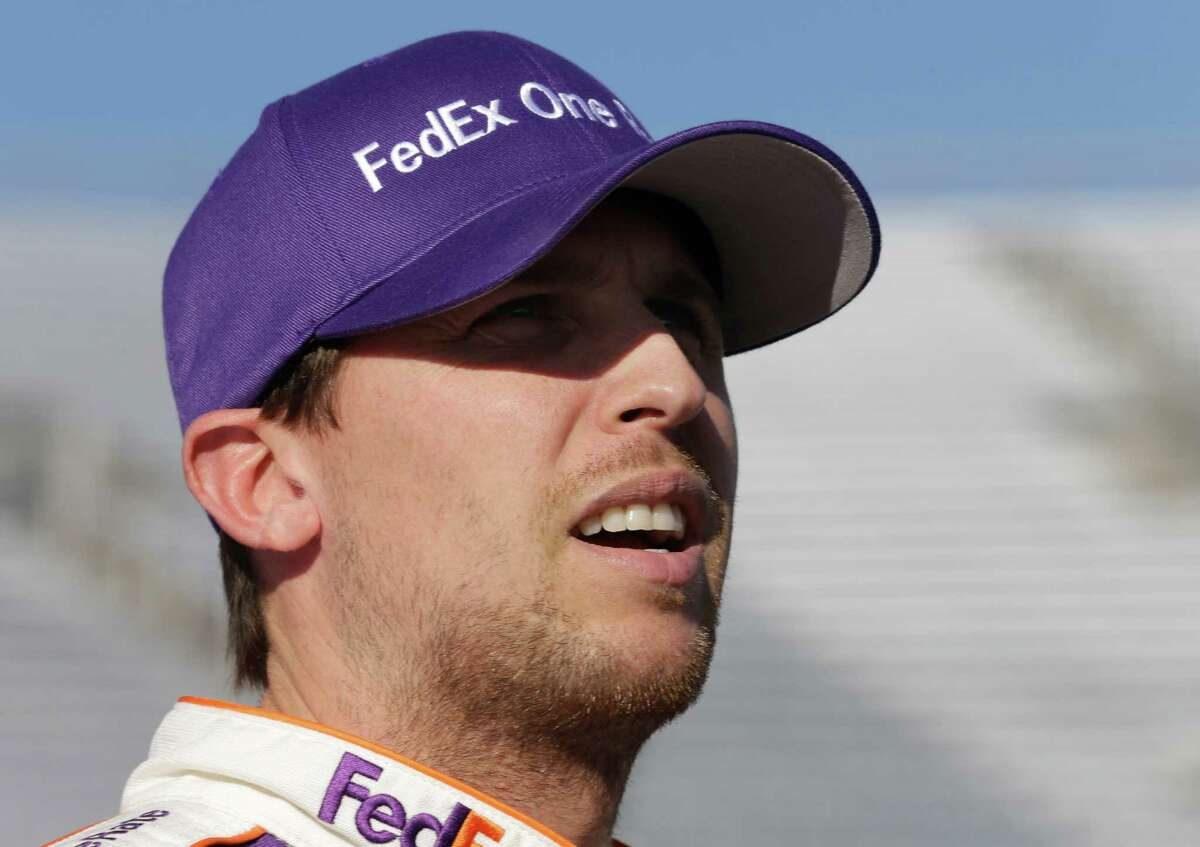 Denny Hamlin watches the scoreboard during qualifying for Sunday's NASCAR Sprint Cup series auto race at Martinsville Speedway in Martinsville, Va., Friday, Oct. 25, 2013. Hamlin won the pole. (AP Photo/Steve Helber) ORG XMIT: VASH104