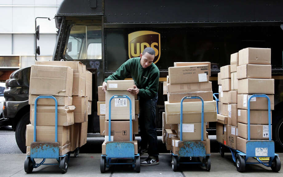 UPS, which found itself overwhelmed with holiday deliveries last year, will hire more season workers. Photo: Mark Lennihan, STF / Associated Press / AP