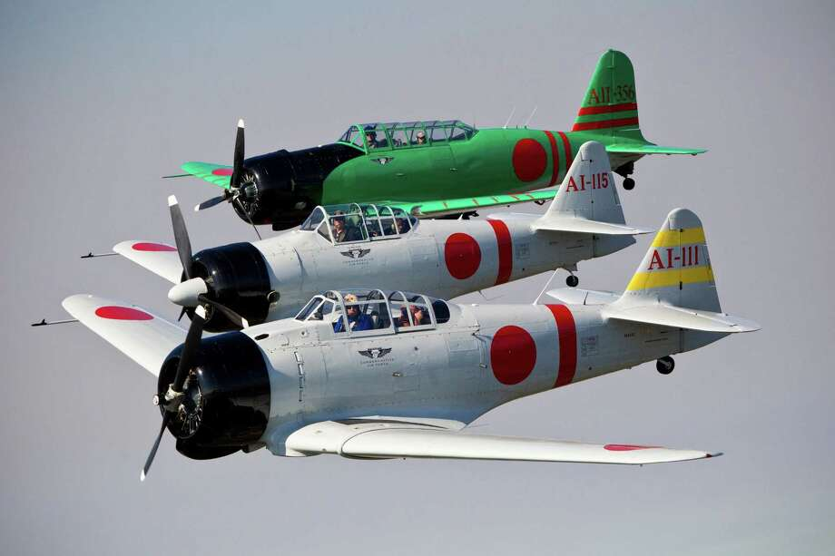 Japanese aircrafts, the AI-111, the AI-115 and AII-356 fly over the coastal area near the Ellington Airport in formation, Friday, Oct. 25, 2013. Photo: Marie D. De Jesús, Houston Chronicle / © 2013 Houston Chronicle