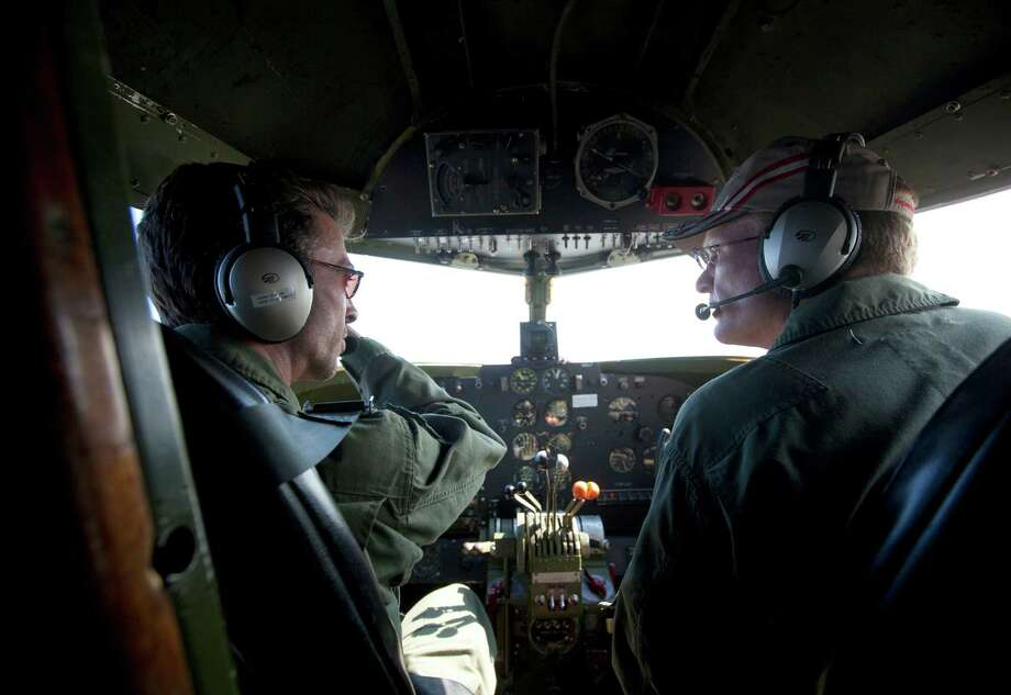 Lockheed C-60A Lodester pilot John Cotter, left, and co-pilot John Bixby fly the former passenger WWII-era aircraft near the Ellington Airport. Photo: Marie D. De Jesús, Houston Chronicle / © 2013 Houston Chronicle