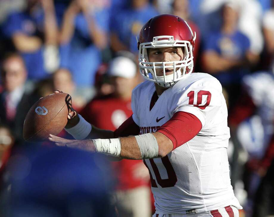 QB Blake Bell and Oklahoma will try to slow down Texas Tech, which is off to its best start since the 2008 season. Photo: Orlin Wagner / Associated Press
