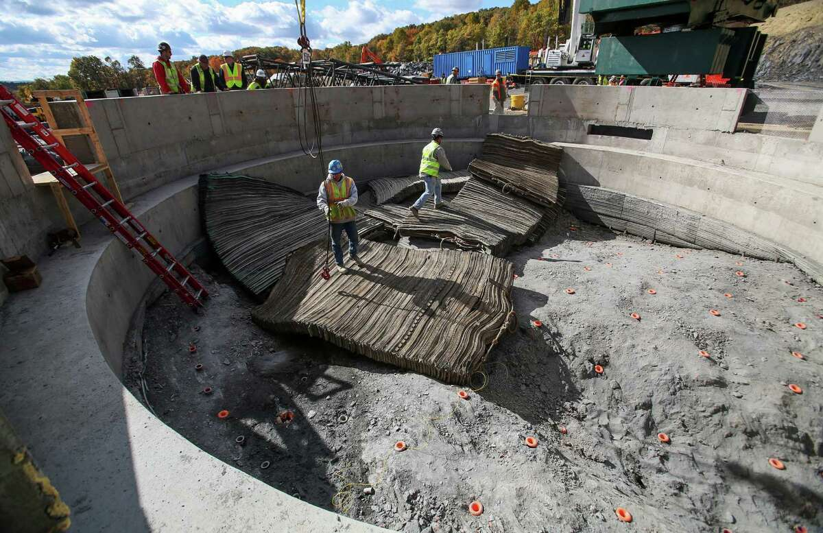 Bill Schwartz, left, and Gabe Phillips walk on blast mats on Thursday, Oct. 24, 2013, in Newburgh, N.Y. Contractors began blasting down 900 feet as DEP begins constructing a $1 billion bypass tunnel so it can shutdown and repair its Rondout-West Branch aqueduct tunnel. (AP Photo/Times Herald-Record, Jeff Goulding) ORG XMIT: NYMID104