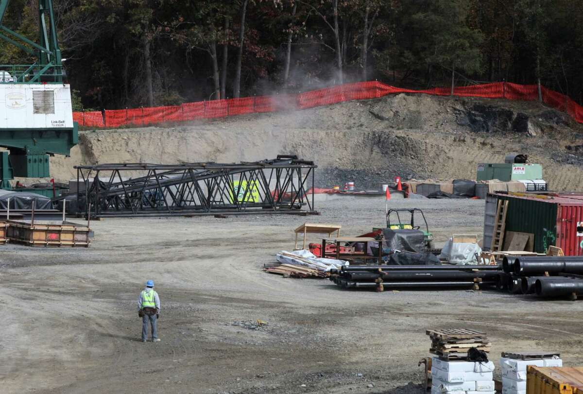 A plume of smoke rises out of the shaft after nearly 400 pounds of explosives were set off on Thursday, Oct. 24, 2013, in Newburgh, N.Y. Contractors began blasting down 900 feet as DEP begins constructing a $1 billion bypass tunnel so it can shutdown and repair its Rondout-West Branch aqueduct tunnel. (AP Photo/Times Herald-Record, Jeff Goulding) ORG XMIT: NYMID102
