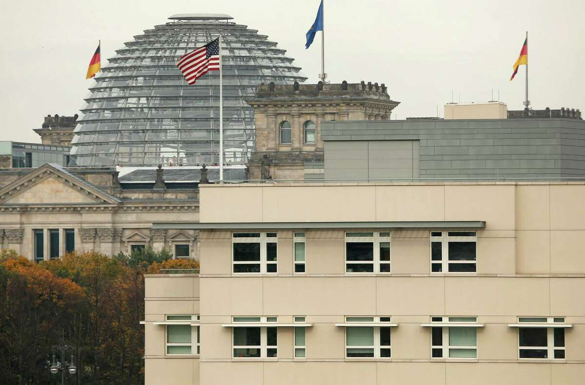 The US flag flies on top of the US embassy in front of the Reichstag building that houses the German Parliament, Bundestag, in Berlin, Germany, Friday, Oct. 25, 2013. European Union leaders on Friday vowed to maintain a strong trans-Atlantic partnership despite their anger over allegations of widespread U.S. spying on its allies. France and Germany insist new surveillance rules should be agreed with the United States by the end of the year.. On Thursday's opening day of the summit, the spying issue united the 28 EU leaders in criticizing the snooping after allegations surfaced that German Chancellor Angela Merkel had one of her mobile phones tapped by U.S. services. (AP Photo/Michael Sohn) ORG XMIT: SOB102