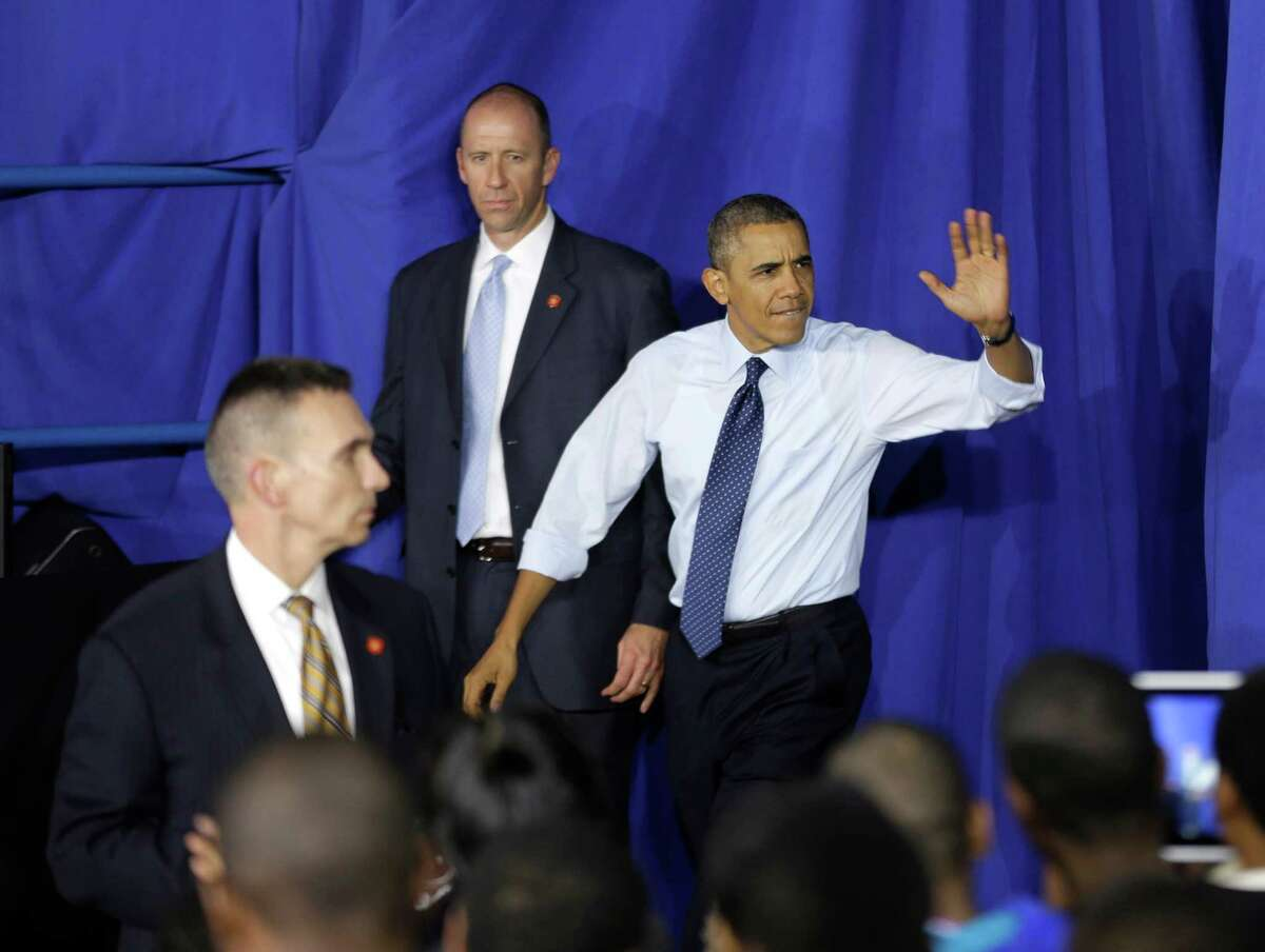 President Barack Obama waves as he arrives to speak at Pathways in Technology Early College High School in Brooklyn, New York, Friday, Oct. 25, 2013. (AP Photo/Seth Wenig) ORG XMIT: NYSW117