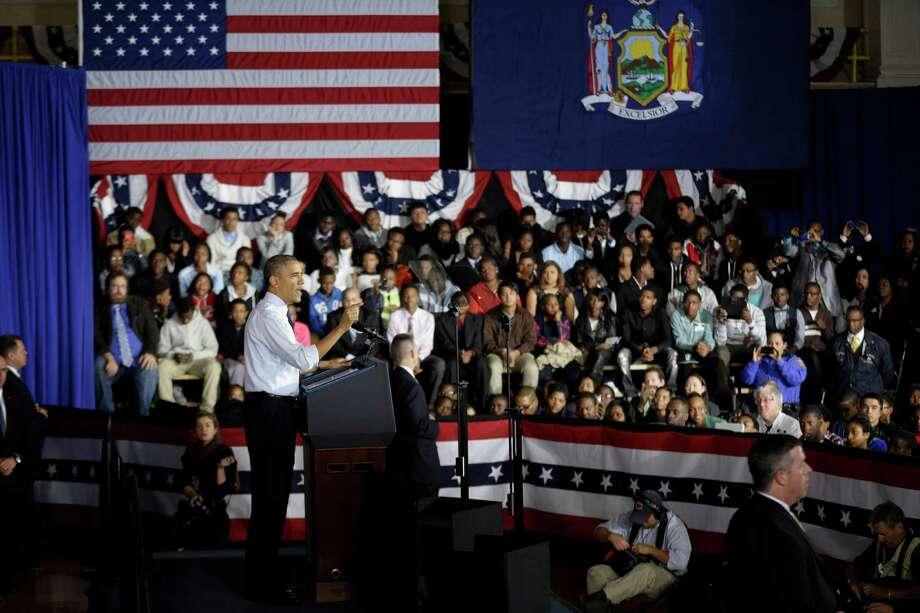 President Barack Obama speaks at Pathways in Technology Early College High School in Brooklyn, New York, Friday, Oct. 25, 2013.  (AP Photo/Seth Wenig) Photo: Seth Wenig / AP