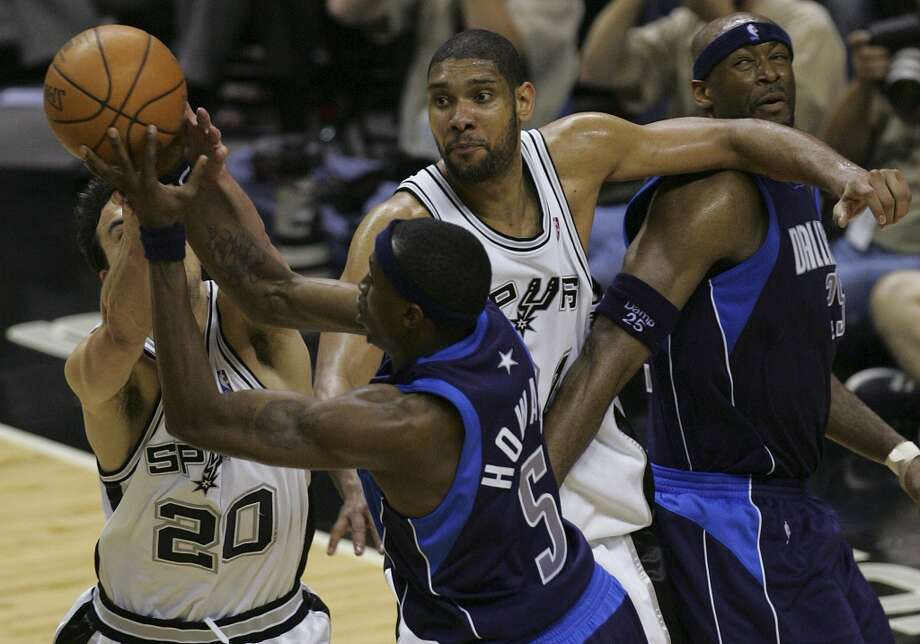 The Spurs' Tim Duncan keeps the Mavericks' Erick Dampier away from the ball as teammate Manu Ginobili battles it out with Dallas' Josh Howard during the Western Conference Semifinals at the AT&T Center on May 7, 2006. Photo: Jerry Lara, San Antonio Express-News