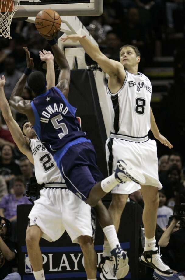 The Spurs' Rasho Nesterovic and Manu Ginboili defend against the Mavericks' Josh Howard during the Western Conference Semifinals at the AT&T Center on May 7, 2006. Photo: Kevin Geil, San Antonio Express-News