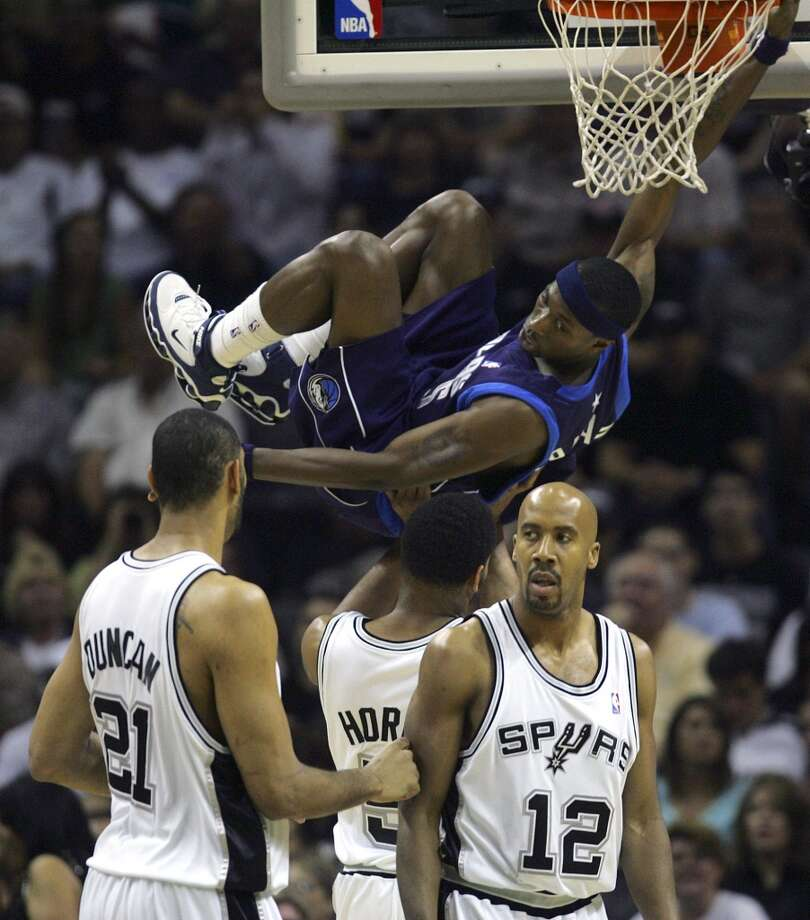 The Mavericks' Josh Howard hangs on the rim after a slam dunk over the Spurs on May 9, 2006, at the AT&T Center during Game 2 of the Western Conference Semifinals. Photo: Bahram Mark Sobhani, San Antonio Express-News