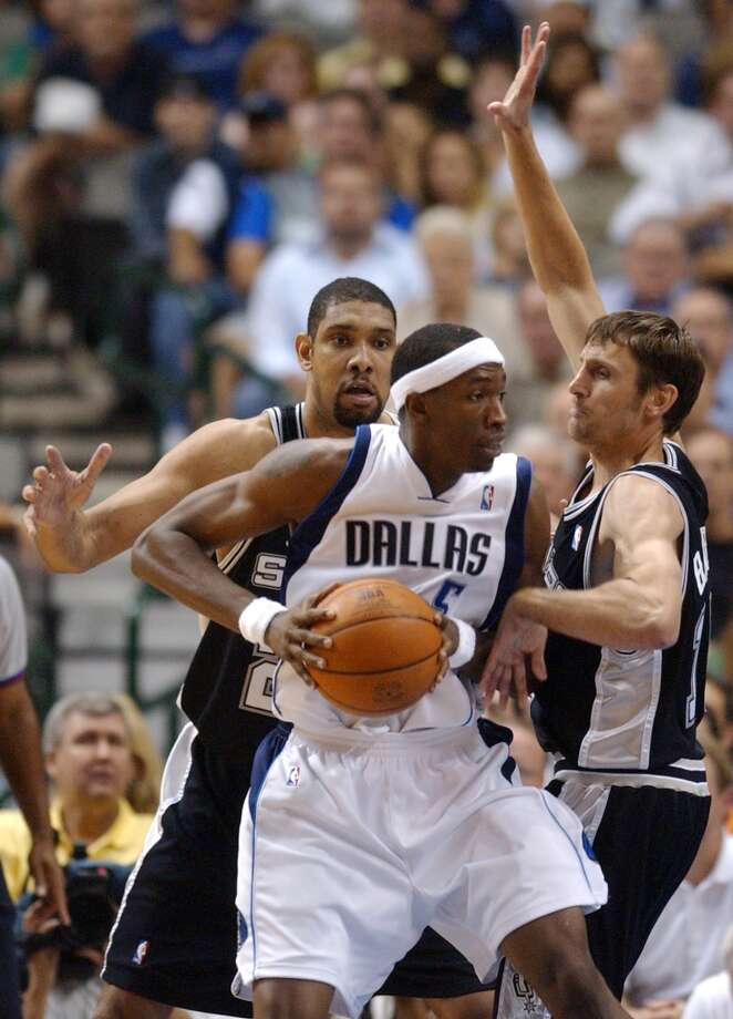 The Spurs' Tim Duncan and Brent Barry double-team the Mavericks' Josh Howard on May 15, 2006, at the American Airlines Center in Dallas during Game 4 of the Western Conference Semifinals. The Mavericks won in overtime 123-118. Photo: Edward A. Ornelas, San Antonio Express-News