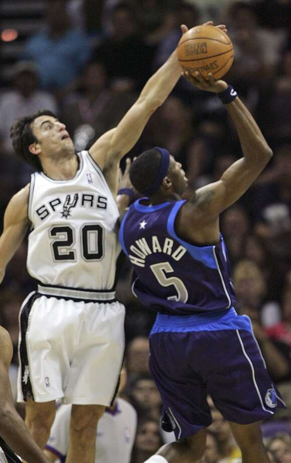 The Spurs' Manu Ginobili blocks the shot of the Mavericks' Josh Howard in the first quarter of Game 5 of the Western Conference Semifinals at the AT&T Center on May 17, 2006. Photo: Kin Man Hui, San Antonio Express-News