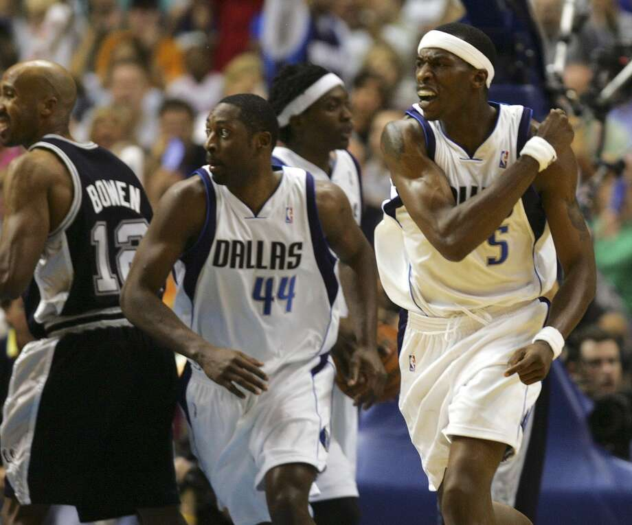 The Mavericks' Josh Howard (5) reacts to scoring against the Spurs as he and teammate Adian Griffen head down court during Game 6 of the  Western Conference Semifinals at the American Airlines Center in Dallas on May 19, 2006. Photo: Bahram Mark Sobhani, San Antonio Express-News