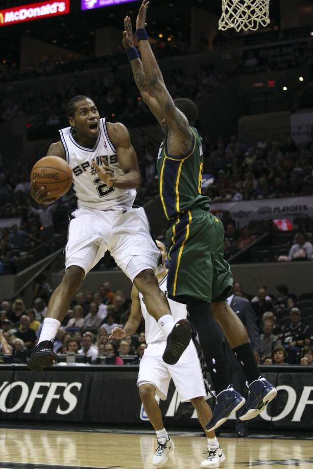 The Spurs' Kawhi Leonard drives to the goal through the Jazz's Josh Howard during Game 2 of the Western Conference first round at the AT&T Center, on May 2, 2012. Photo: Jerry Lara, San Antonio Express-News