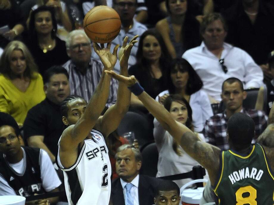 The Spurs' Kawhi Leonard (2) shoots a successful three-point shot over the Jazz's Josh Howard during NBA playoffs action at the AT&T Center on May 2, 2012. Photo: Billy Calzada, San Antonio Express-News