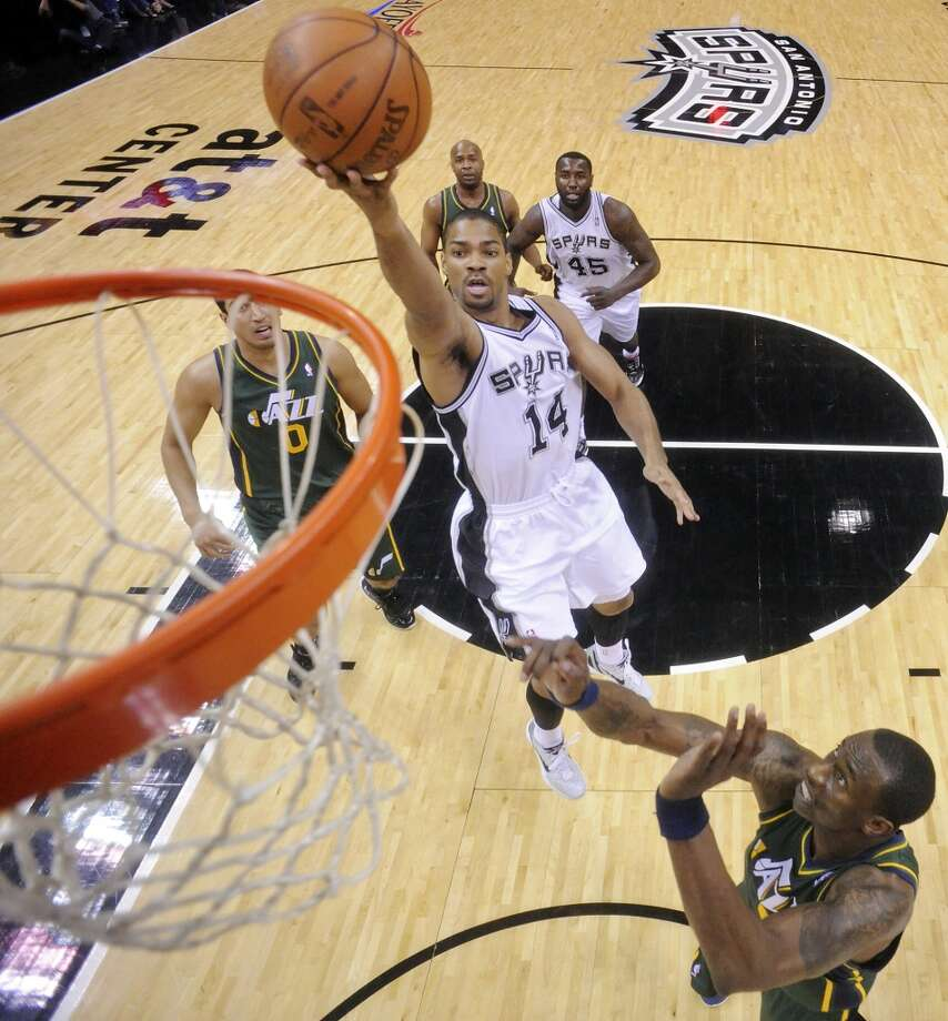 The Spurs' Gary Neal shoots over the Jazz's Josh Howard during first half action of Game 2 of the Western Conference first round on May 2, 2012, at the AT&T Center. Photo: Edward A. Ornelas, San Antonio Express-News