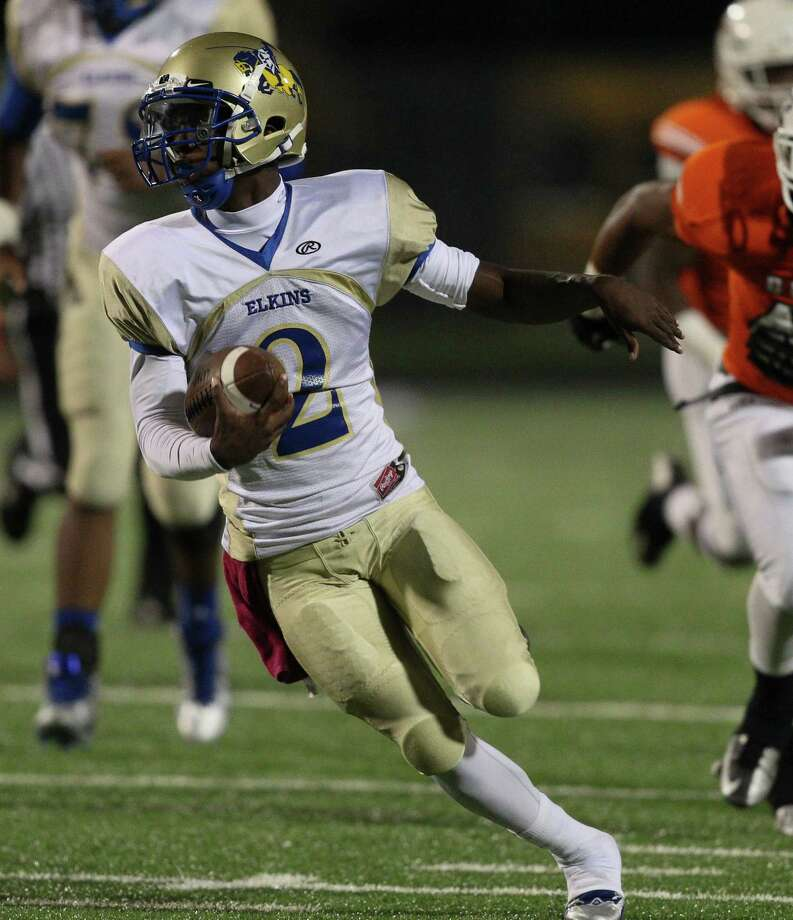 Fort Bend Elkins quarterback Jonathan Giles (2) rushes in the first quarter during a high school football between Fort Bend Bush and Fort Bend Elkins Friday Oct. 25, 2013 in Missouri City, Texas. Photo: Bob Levey, Houston Chronicle / ©2013 Bob Levey