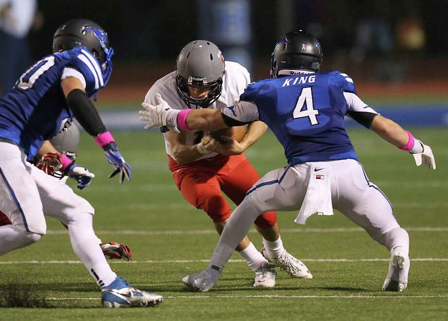 10/25/13: Dawson's Drake Rainer #18 is tackled and fumbles the ball against Friendswood's  Blake King #4 in a high school football game at Winston Stadium in Friendswood, Texas.Friendswood won 31 to 14. Photo: Thomas B. Shea, Houston Chronicle / © 2013 Thomas B. Shea