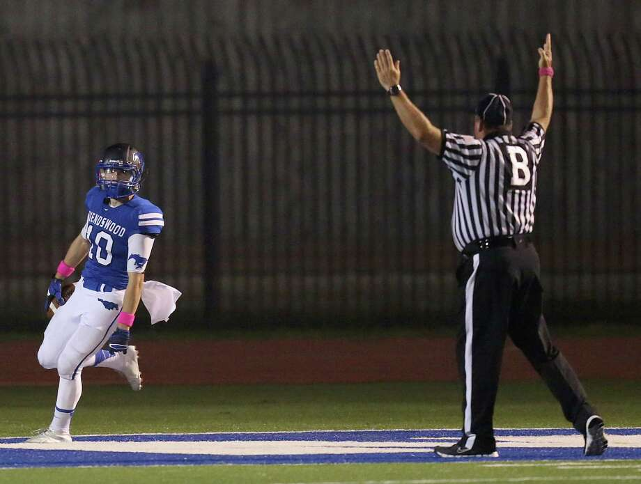 10/25/13: Friendswood's Brandon Sargent #9 completes a pass to Slade Holle # 0 for a touchdown reception against Dawson's  in a high school football game at Winston Stadium in Friendswood, Texas.Friendswood won 31 to 14. Photo: Thomas B. Shea, Houston Chronicle / © 2013 Thomas B. Shea