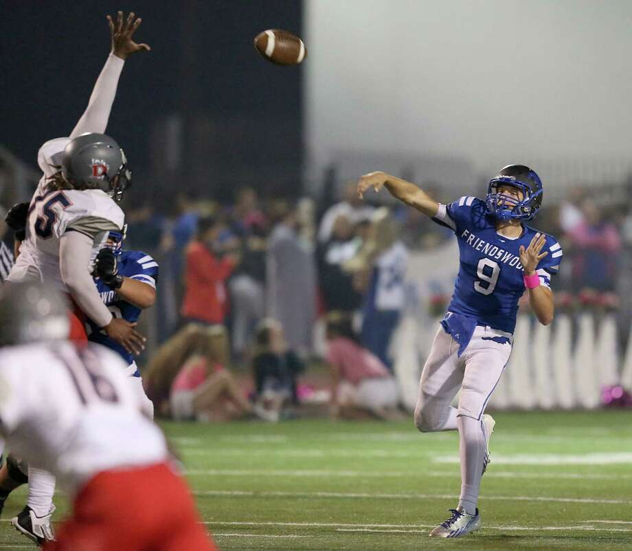 10/25/13: Friendswood's Brandon Sargent #9 completes a pass to Slade Holle # 10 against Dawson's  in a high school football game at Winston Stadium in Friendswood, Texas.Friendswood won 31 to 14. Photo: Thomas B. Shea, Houston Chronicle / © 2013 Thomas B. Shea