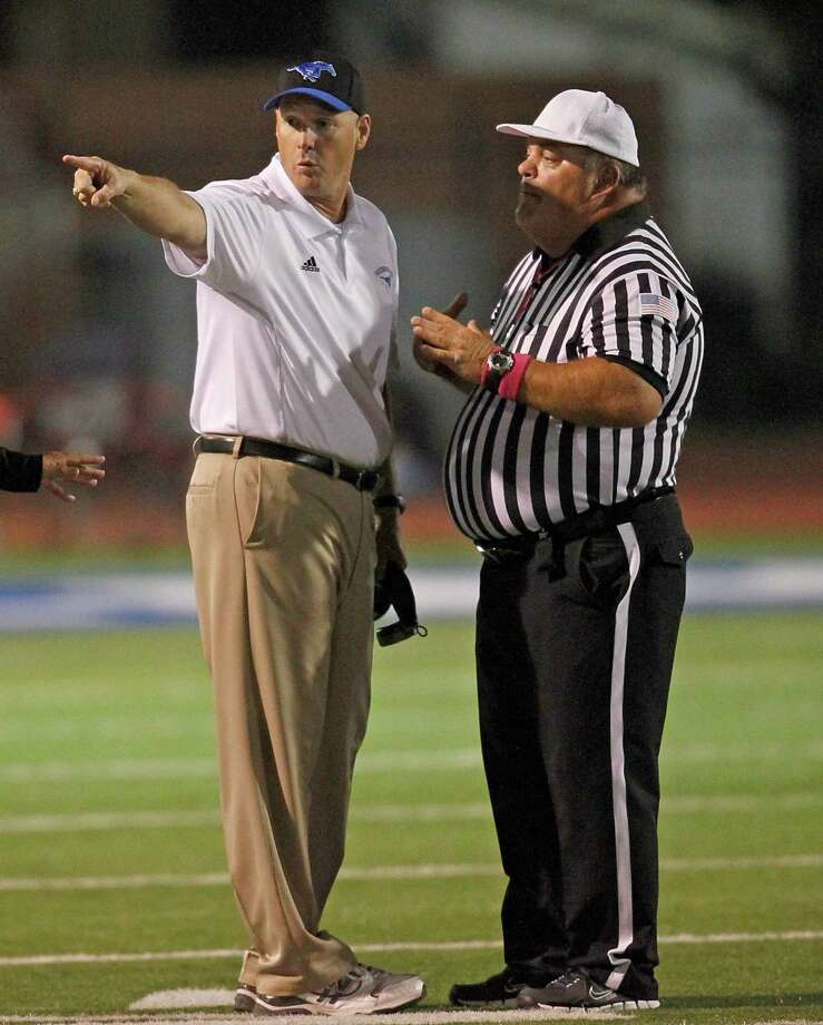 10/25/13: Friendswood's head coach Robert Koopman argues with an official while playing against Dawson in a high school football game at Winston Stadium in Friendswood, Texas. Photo: Thomas B. Shea, Houston Chronicle / © 2013 Thomas B. Shea