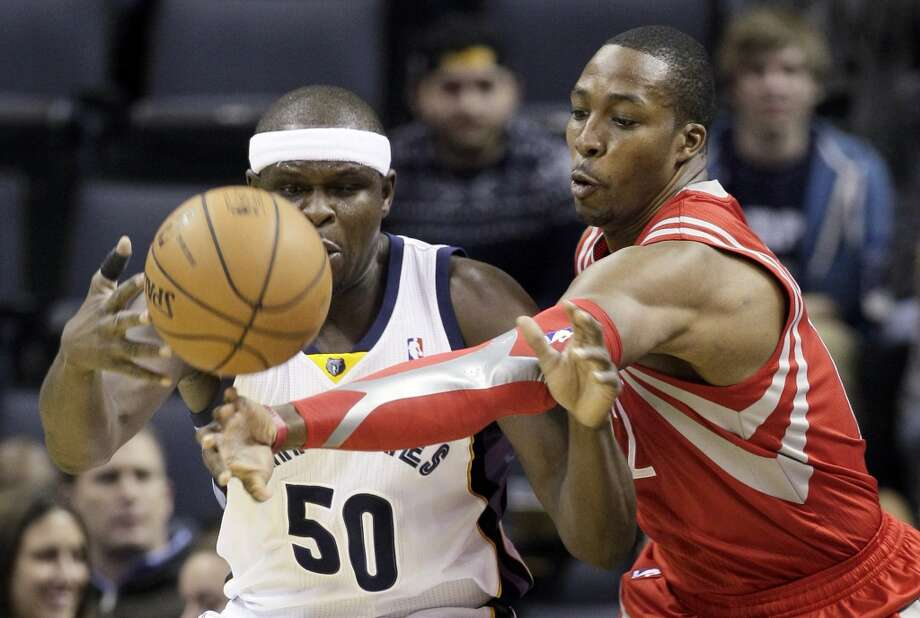 Rockets 92, Grizzlies 73  Dwight Howard, right, slaps the ball away from Zach Randolph (50). Photo: Danny Johnston, Associated Press