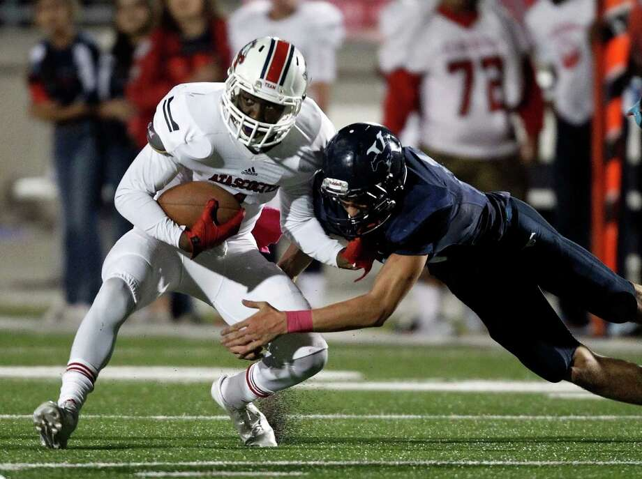 Atascocita's Quan Shorts, left, is tackled by Kingwodd's Zach Cotter during the first half of a high school football game, Friday, October 25, 2013 at Turner Stadium in Humble. Photo: Eric Christian Smith, For The Chronicle