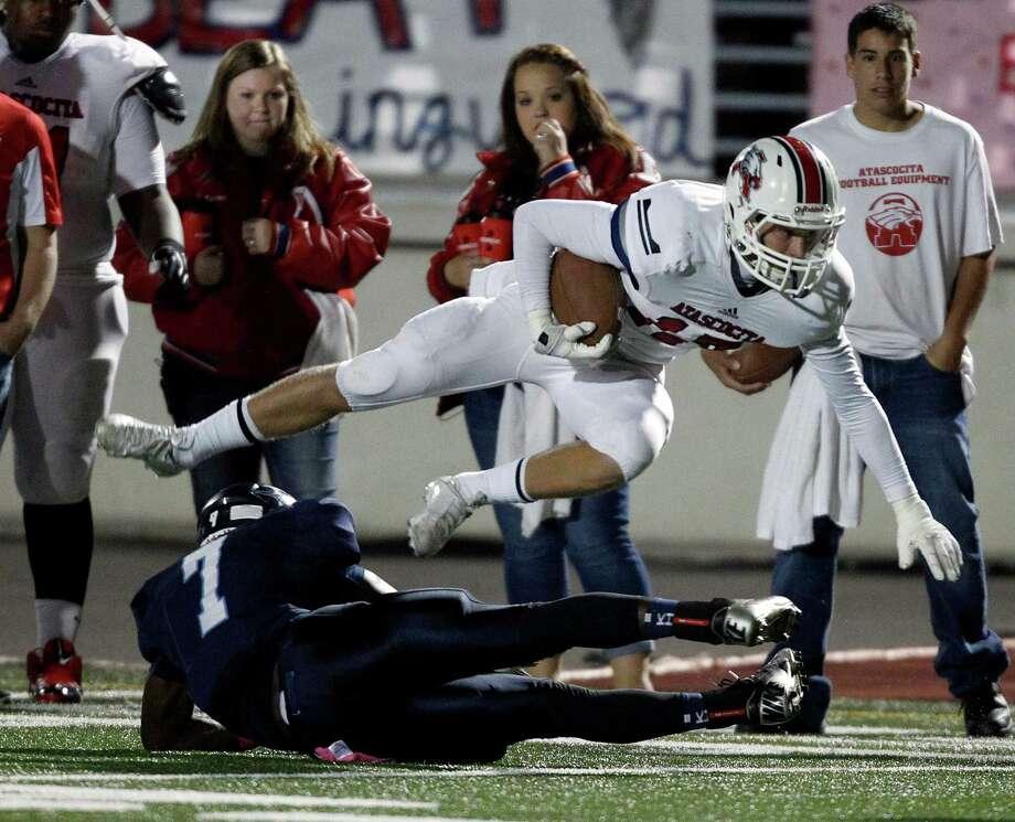 Atascocita's Taylor Stump (17) is tackled by Kingwood's Isaiah Shepherd during the first half of a high school football game, Friday, October 25, 2013 at Turner Stadium in Humble. Photo: Eric Christian Smith, For The Chronicle