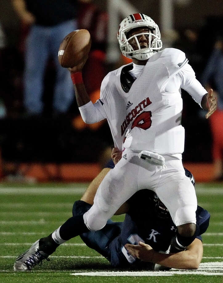 Atascocita's Greg Campbell (10) is sacked by Kingwood's Ryan Woodruff during the first half of a high school football game, Friday, October 25, 2013 at Turner Stadium in Humble. Photo: Eric Christian Smith, For The Chronicle