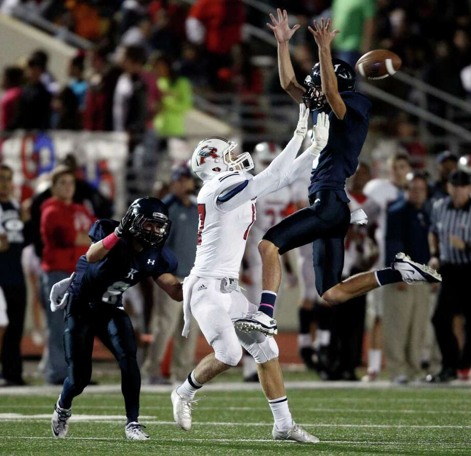Kingwood's Ethan Powell, right, breaks up a pass intended for Atascocita's Taylor Stump as Kingwood's Logan Clift defends during the first half of a high school football game, Friday, October 25, 2013 at Turner Stadium in Humble. Photo: Eric Christian Smith, For The Chronicle