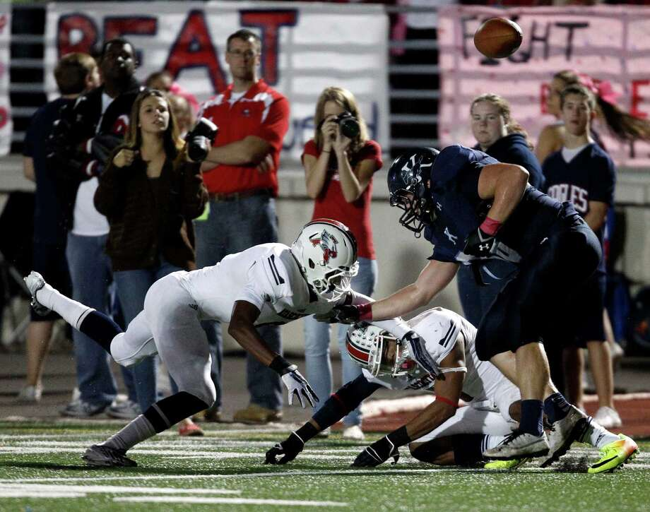 Kingwood's Josh Cochran, right, fumbles the ball after being tackled by Atascocita's Jay Edwards, left,  during the first half of a high school football game, Friday, October 25, 2013 at Turner Stadium in Humble. Photo: Eric Christian Smith, For The Chronicle