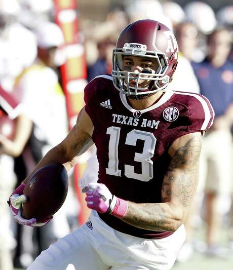 Texas A&M's Mike Evans says he's focused on his 17-month-old daughter Mackenzie and the Aggies' season — not the NFL. Photo: Thomas B. Shea / Getty Images