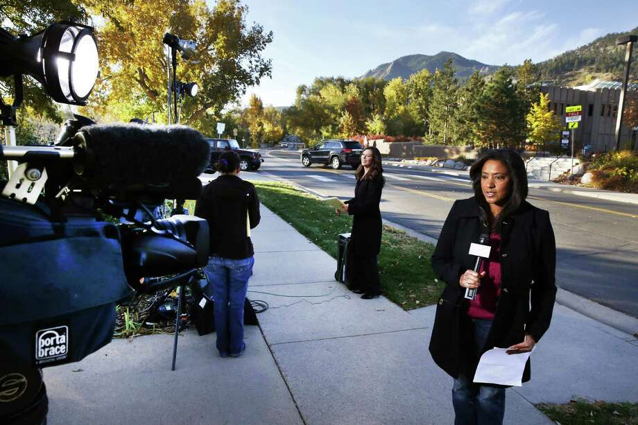 After new court documents were released Friday in 1996 death of 6-year-old JonBenet Ramsey, TV correspondents broacast live in front of the Boulder County Justice Center in Boulder, Colo. Photo: Associated Press