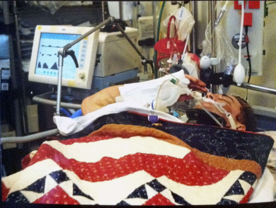 "Army Cpl. Josh Hargis appeared to be unconscious when he raised his right arm to salute his regimental commander from a hospital bed in Afghanistan. Some refer to the scene as ""the salute seen around the world,"" as it's gone viral on the Net. Photo: Courtesy Of Taylor Hargis"